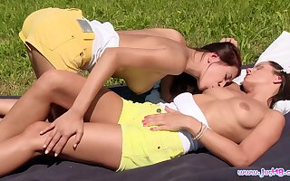 Outdoor lesbian dalliance for teen dolls Christy Charming together with Kari K.